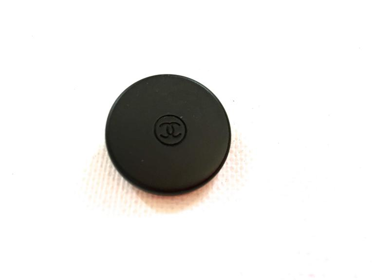 Presented here is a set of 5 buttons from Chanel. Each button is a matte finish metal button. The buttons are black with the iconic CC logo inscribed in the center of a circle of each button. The buttons each measure 1 inch in diameter. It is