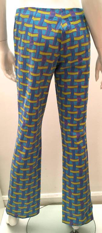 Presented here is a fabulous pair of pants from Roberta di Camerino. These rare pants are a beautiful pattern comprised of light blue, blue, light olive green and light purple. The graphics are images of a weaving of what appear to be varying colors