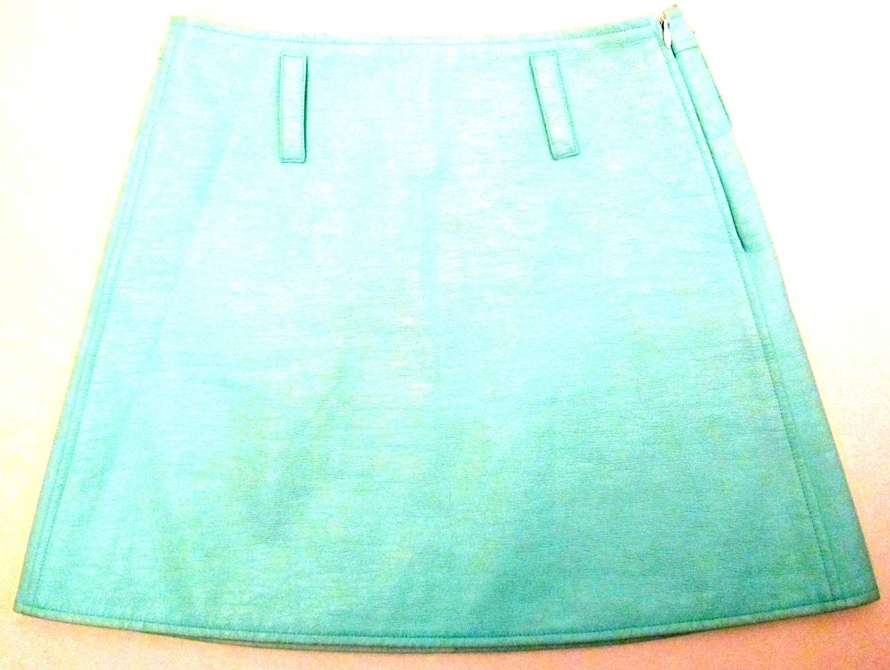 Well, this is why I love Courreges! This lovely sea foam / aqua mini skirt makes you feel like you are Sharon Stone in the movie Casino! This patent skirt is in mint condition. It is from Courreges Paris and is marked a size 34. It is made in France