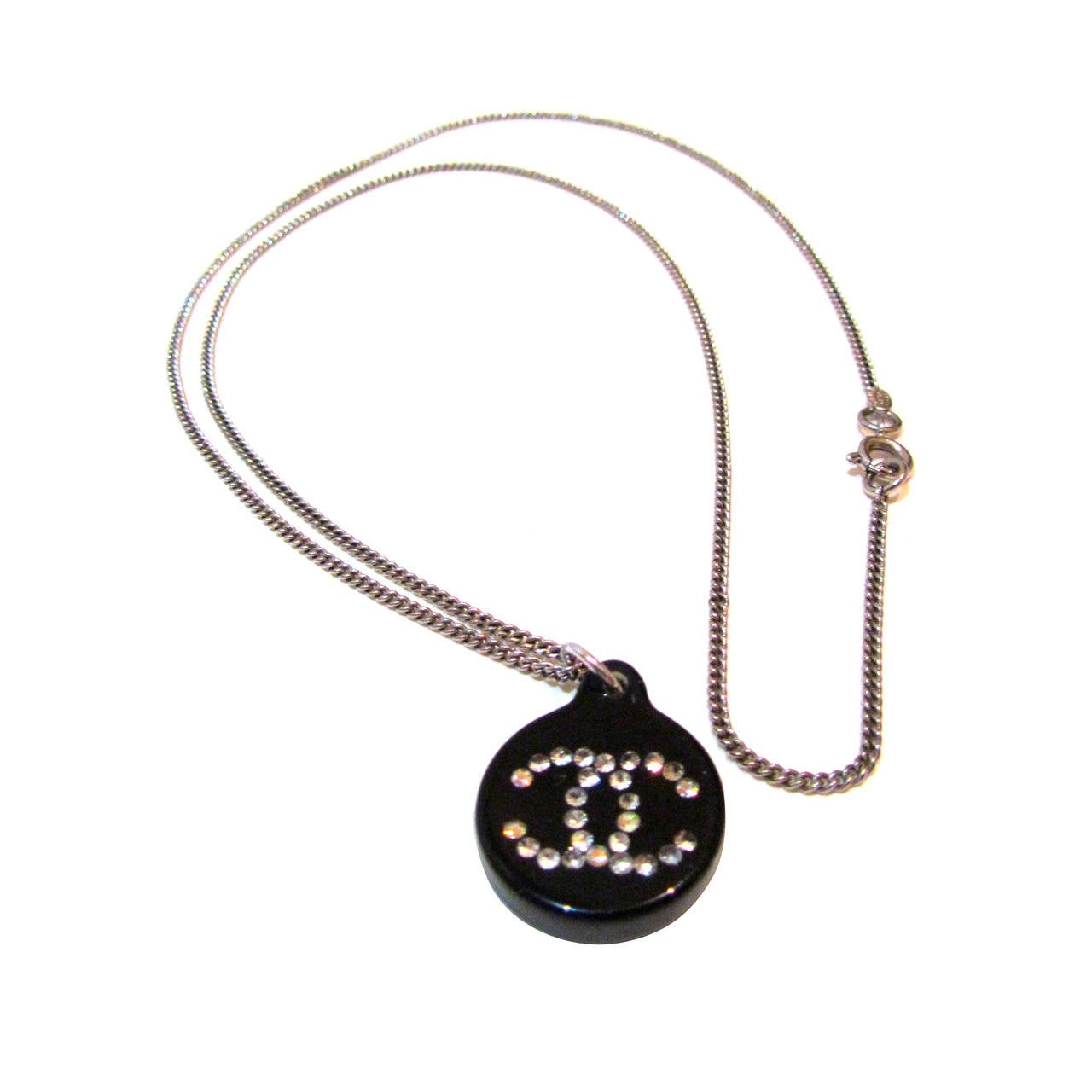 Chanel Necklace - Silver Tone Chain - Black Resin Charm with Crystal CC Inlay For Sale