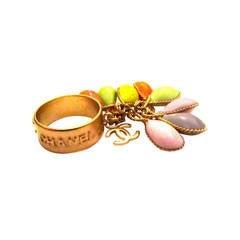 Chanel Gold Tone Ring - Dangling CC Logo and Pastel Stones - Size 6.5