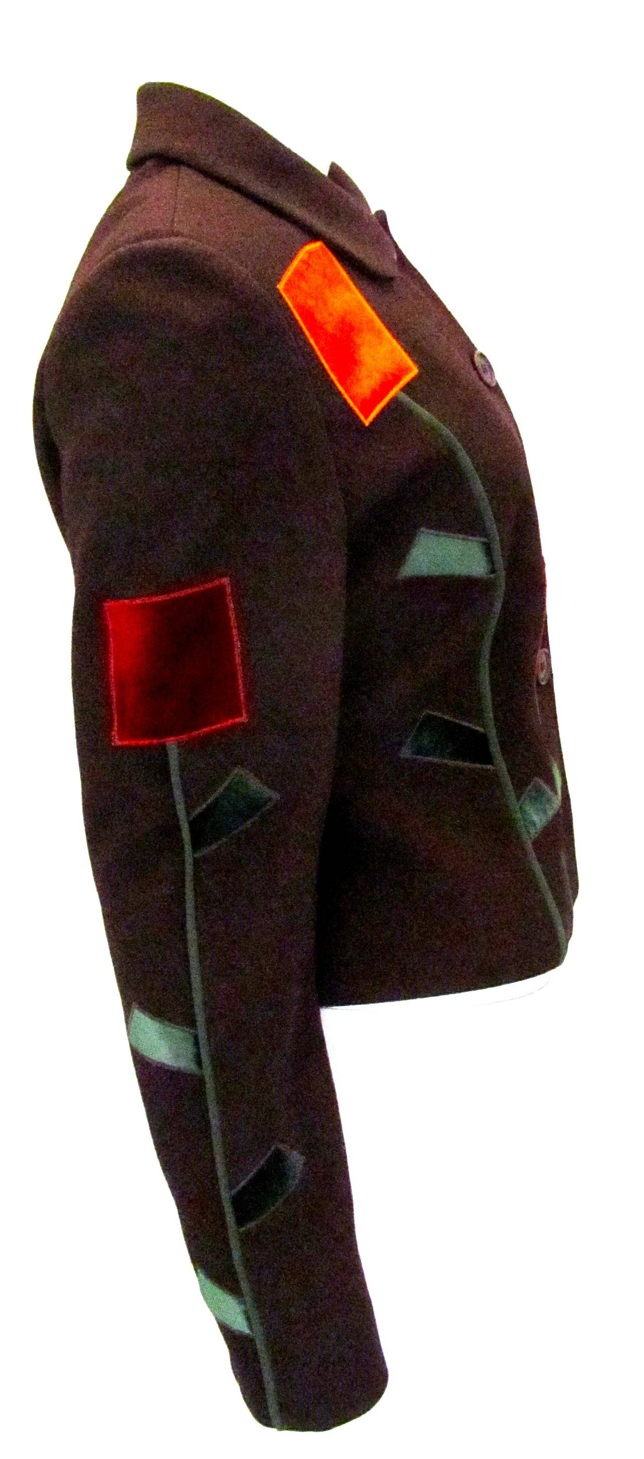 Moschino Cheap and Chic blazer with geometric flower design. The blazer is 75% rayon and 25% wool. The flowers are a soft shiny velvet and are orange, red, and green. Jacket is in excellent condition and is a magnificent example of Moschino's design