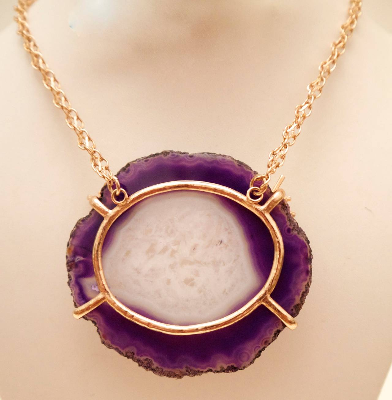 Chanel purple and white agate cross section necklace. This couture piece was only made available in Chanel Boutiques and was produced in extremely limited quantities. This particular necklace has a gold tone chain, and the chain has gold tone star