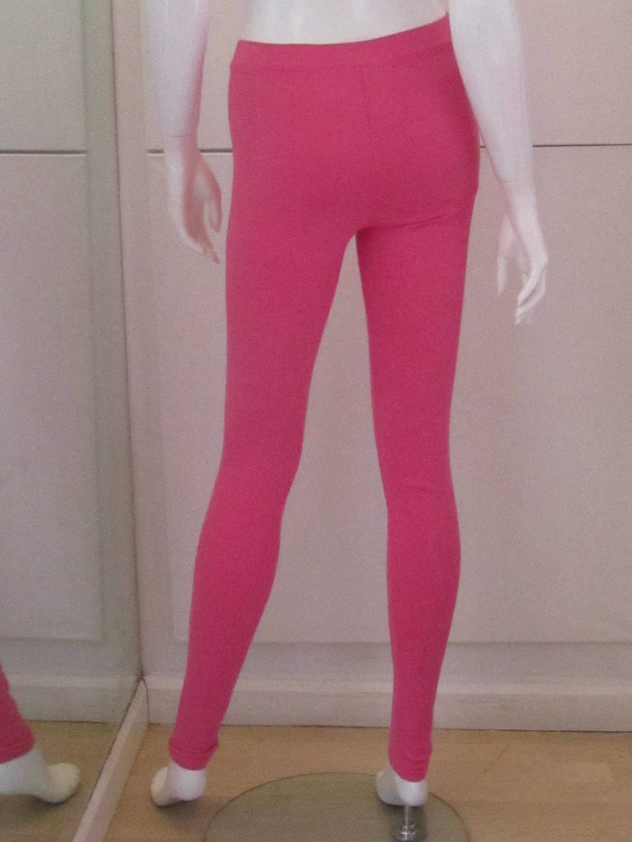 These hot pink Chanel leggings are a size 38. The fabric content is 76% viscose - rayon. 24% polyester. They are made in Italy. The pants have been worn once and they are stretch pants so depending upon size wear them loose or tight, though they are