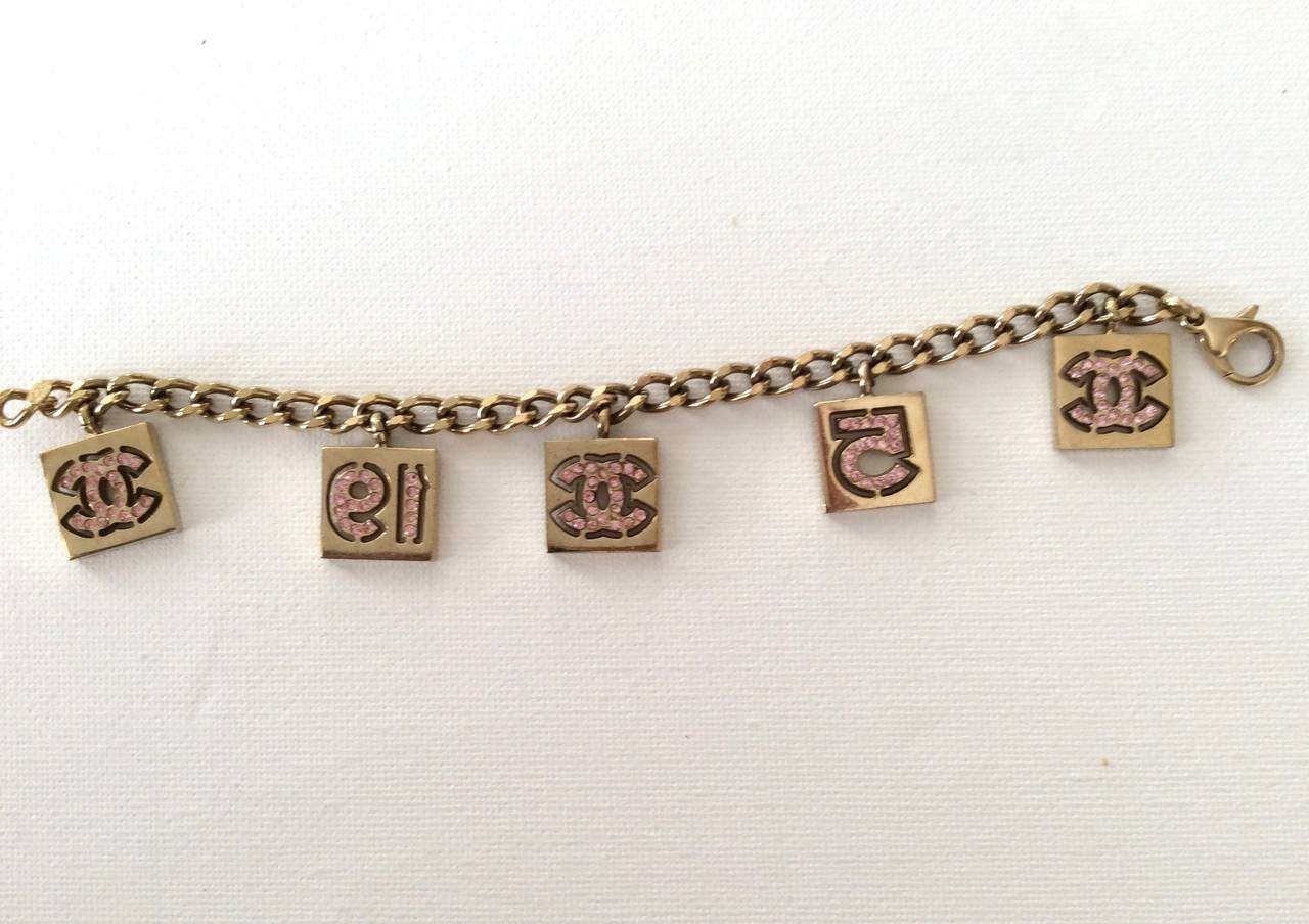 Women's Vintage Chanel Gold Tone with Pink Rhinestone Charm Bracelet For Sale
