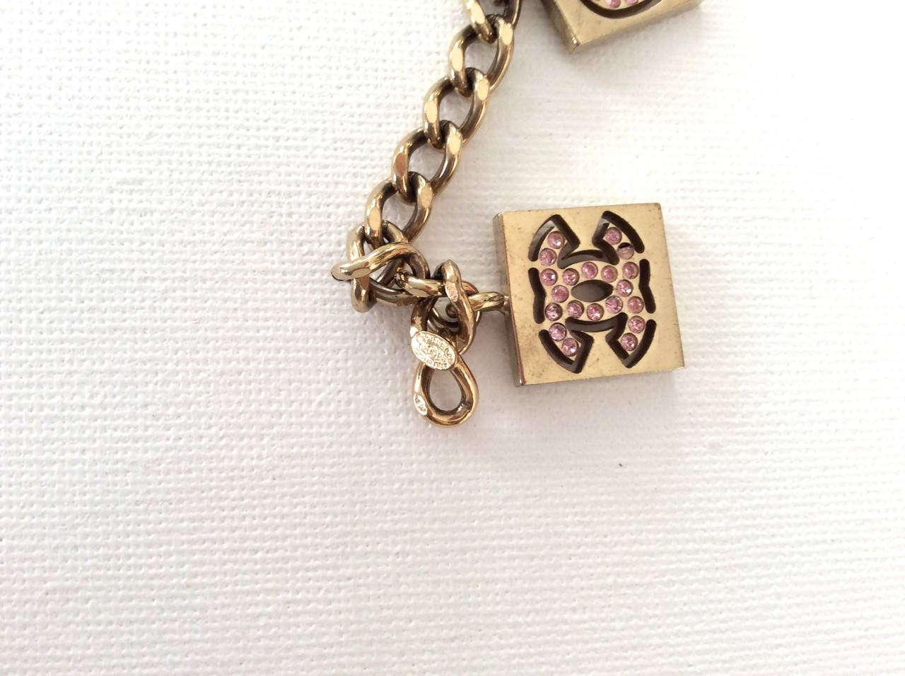 Vintage Chanel Gold Tone with Pink Rhinestone Charm Bracelet In Excellent Condition For Sale In Boca Raton, FL