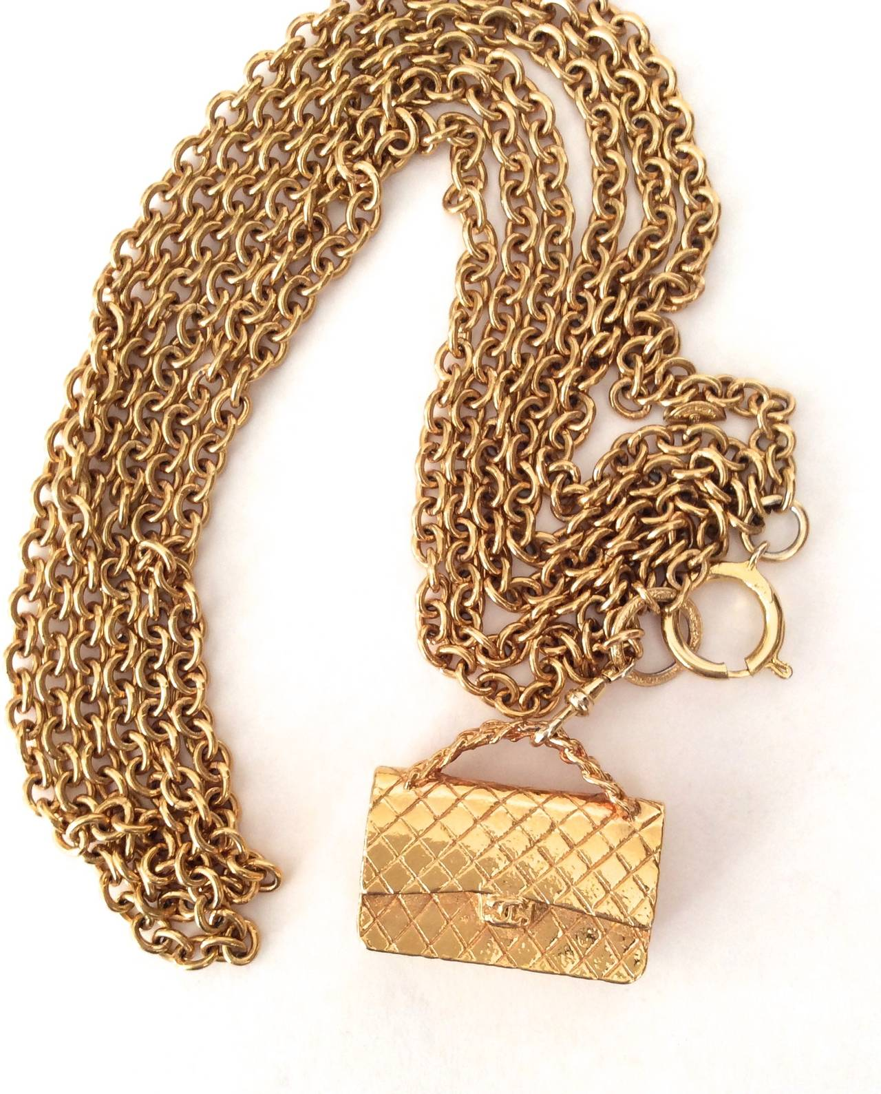 Gold Tone Chanel Triple Chain Necklace with Iconic Purse Pendant 9