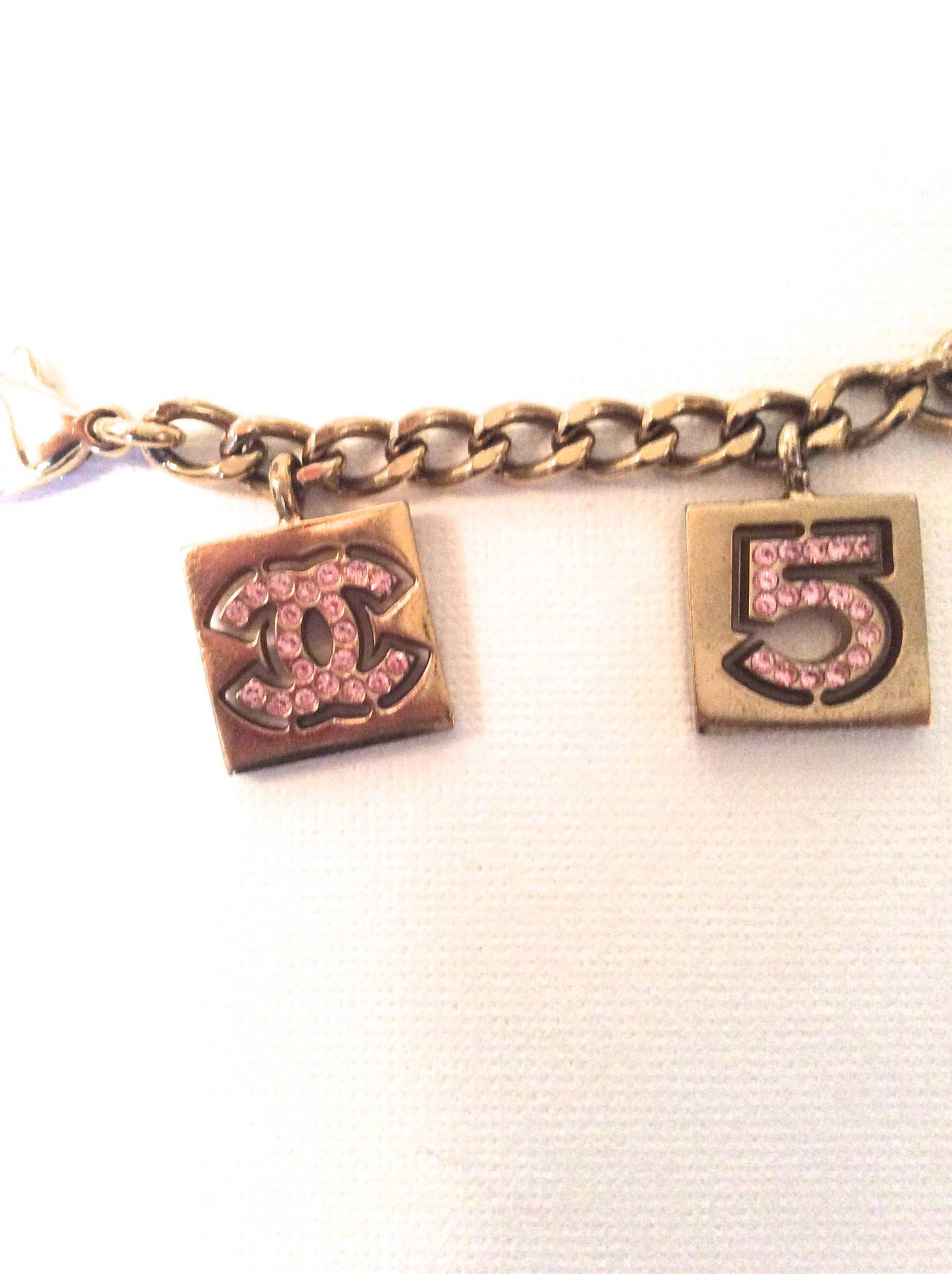 Vintage Chanel Gold Tone with Pink Rhinestone Charm Bracelet For Sale 2