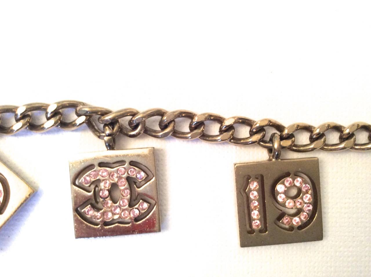 Vintage Chanel Gold Tone with Pink Rhinestone Charm Bracelet For Sale 1