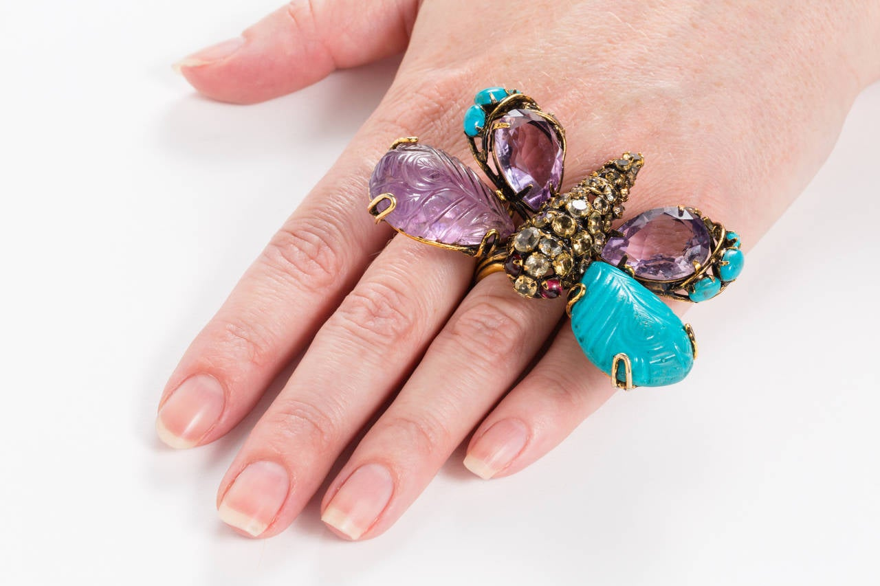 Dramatic ring with carved turquoise and amethyst stones, in a brass setting. Citrine and rhinestones decorate the body of the butterfly. The ring is slightly adjustable, from approximately size 7 - 7.5. Currently adjusted to 7.5.