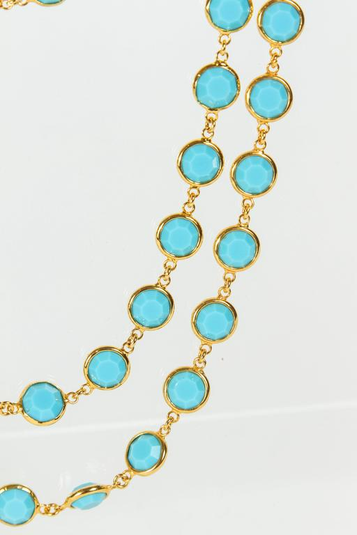 Lovely Chanel suitor with faceted turquoise stones (glass) set in gilt metal bezels. This necklace is in amazing condition. An oval tag is imprinted with