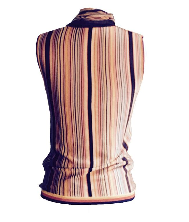 """Hermes Paris Multicolor striped knit sleeveless v-neck with matching knit scarf attached at back neck.   100% viscose/rayon.  Made in France.  Size FR 34, approximate US 2/4. Bust 31"""". Waist 29"""". Length 24"""".  Body of sweater is in"""