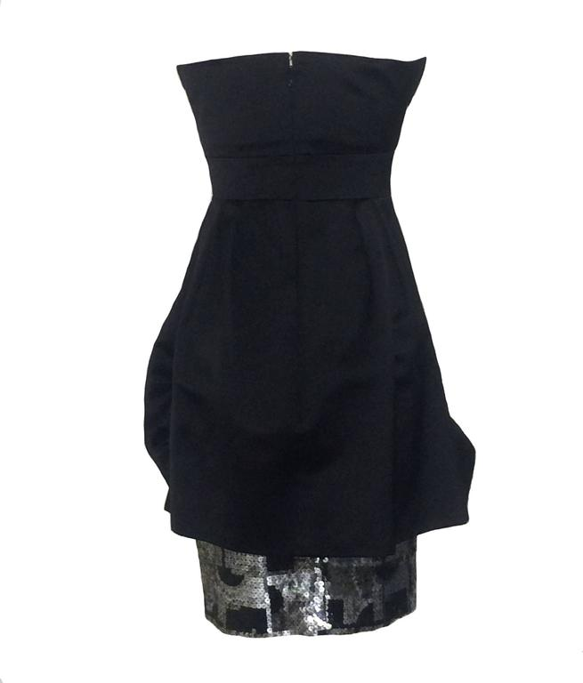 Christian Lacroix black silk draped bubble skirt cocktail dress with geometric silver and black sequin trim peeking out from skirt and on one side of top chest. Very thin spaghetti straps that can be worn or tucked in. Back zip and hook and eye.