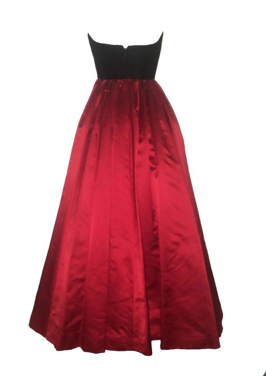 "Oscar de la Renta 1990's black and red evening gown featuring a semi-boned ""Madame X' shaped velvet bodice and a very full red satin circle skirt. Crinoline panels and a separate taffeta underskirt add further volume to skirt.