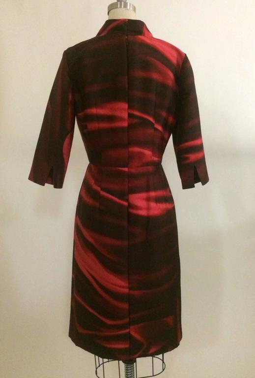 Oscar de la Renta printed silk mikado slim fit shirt dress in red/merlot. Split cuffs, fully lined. Concealed hook and zip fastenings at back.   100% silk. Fully lined in 100% silk.   Made in USA.  Size 6. Non-stretchy fabric. Bust 35