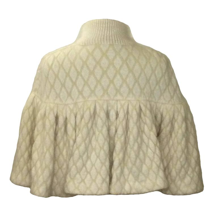 Alexander McQueen by Sarah Burton Fall/Winter 2013 cream capelet in a diamond-knit jacquard. Super soft & fuzzy blend of 56% angora, 25% polyamide, and 19% viscose.  Fastens closed at front with hidden snaps from neck to bottom.  Size Small.