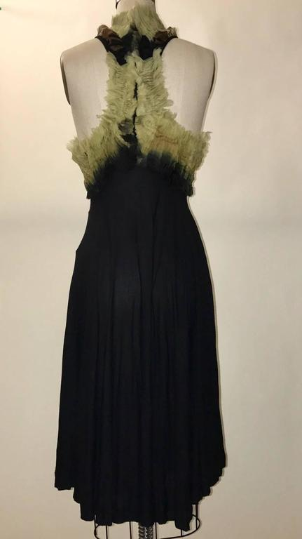 Alexander McQueen 2010 super soft black knit dress with distressed organza swirls at racer back top. Back zip at organza top.   100% viscose rayon.  Made in India.  Size IT 44, approximate US 8. See measurements. Bust 37