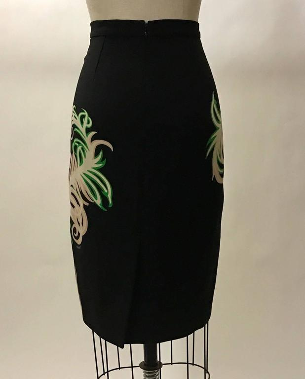 Vionnet recent collection black pencil skirt with cream, pink, and green feather print. Back slit and back zip with hook and eye.  82% virgin wool, 18% nylon polyamide.  Made in Italy.  Size IT 40, approximate US 4. Runs slightly small, see