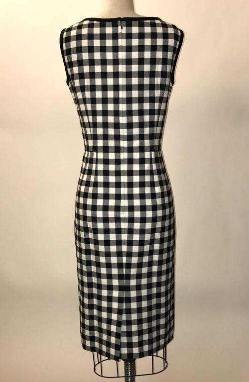 Dolce and Gabbana recent season black and white checked and slightly textured sleeveless pencil cut sheath dress. Back zip and hook and eye.  100% cotton. Fully lined in 96% silk, 4% elastane.  Made in Italy.  Size IT 44, approximate US 8. See