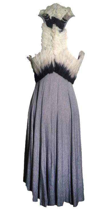 Alexander McQueen 2010/2011 collection super soft grey rayon jersey dress with an empire bodice decorated in pleated, raw edged ombre organdy. Racer back with swingy circle skirt.   Assymetrical hem is longer in center front/back than on sides. Back