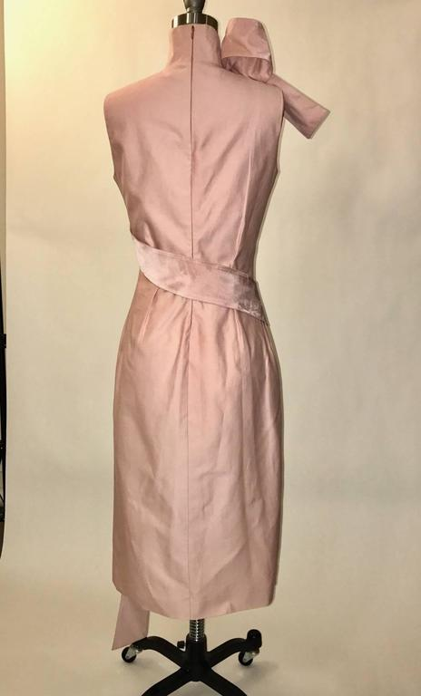 Alexander McQueen pink dress from his acclaimed Spring Summer 2001 Voss collection. High neck, very fitted style with a pink ribbon wrapping around the body and ending in a sculptural loop at neck. Back zip.  73% cotton, 23% silk. Fully lined in