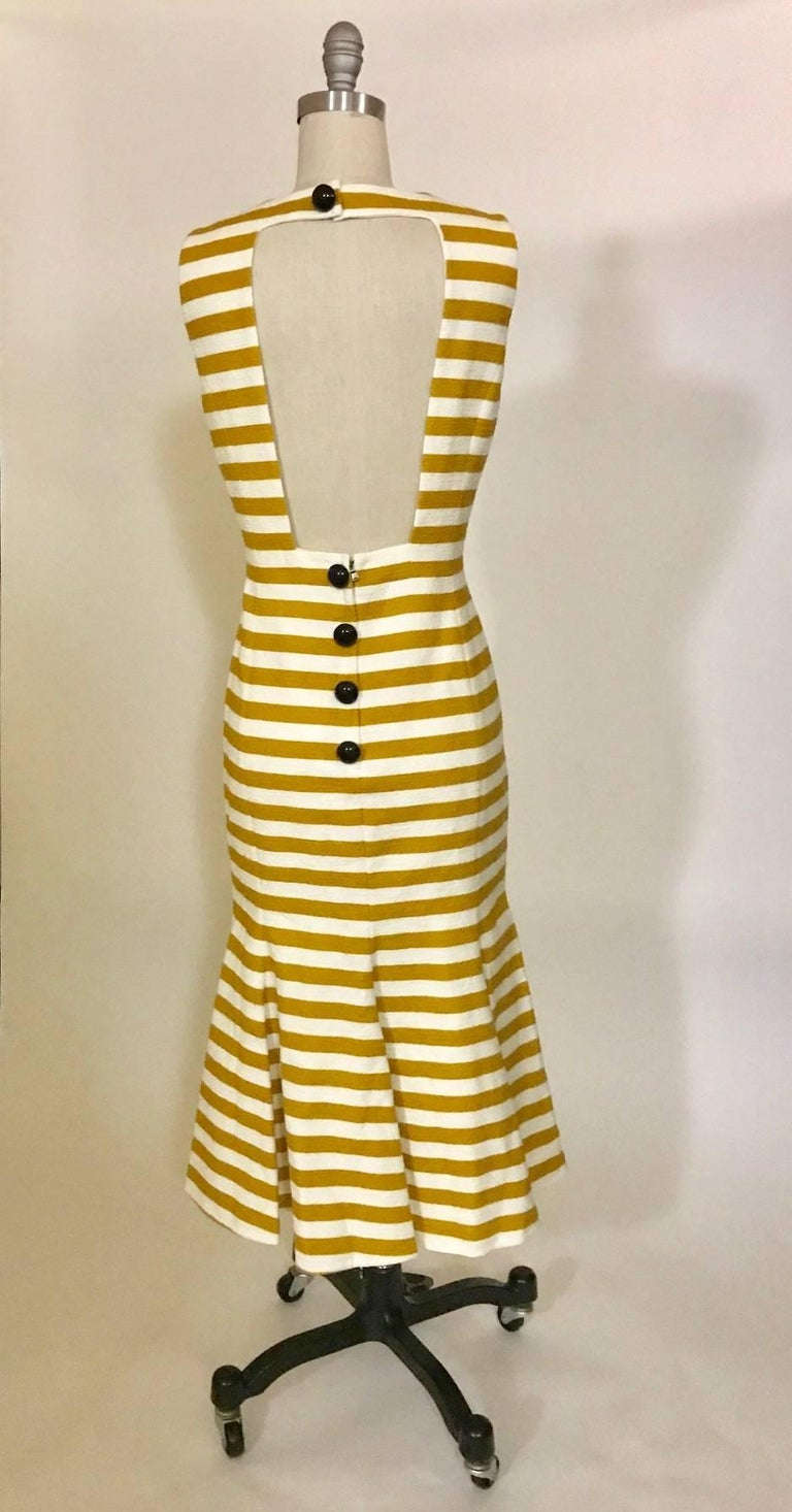 Dolce & Gabbana dark mustard yellow and white striped textured cotton blend sleeveless midi dress with a fitted bodice and flirty flared bottom. Handcrafted beading illustrates the Tower of Pisa, while appliquéd 'Pisa' lettering and embroidered and