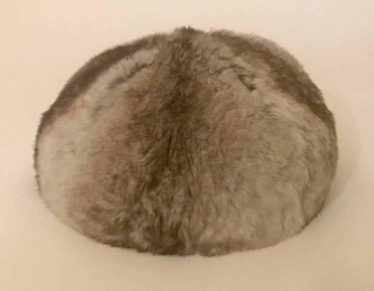 Vintage Christian Dior 1960s fur hat, unworn with tags attached. Sold at Rich's department store. Styled to sit just atop the head. Grosgrain band at interior, comb at back holds hat in place. Fully lined.  Signed 'Christian Dior Chapeaux, Paris -