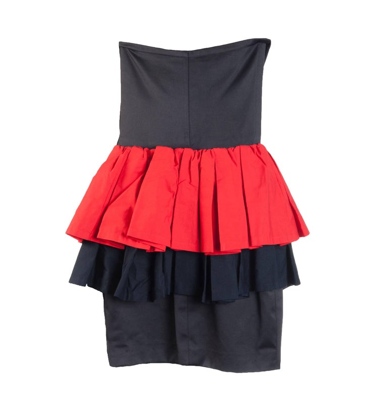 Yves Saint Laurent Rive Gauche vintage 1990s red and black dress with red and black ruffle peplum. Boned at bodice. Side zip and hook and eye.   100% cotton. Lined in cotton at top and 55% acetate, 45% rayon at skirt.   Made in France.  Size FR 36,