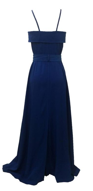 Jean Paul Gaultier Femme blue maxi dress with trench coat detailing. Thin straps can be unsnapped at back to create a criss-cross or halter style. 
