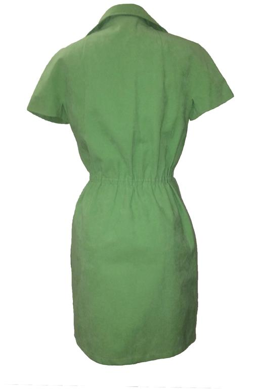 Halston 1970s short sleeve mint green ultra suede wrap style dress. Ties at interior and hooks at exterior.  Elasticized waist, hidden pockets at side seams.