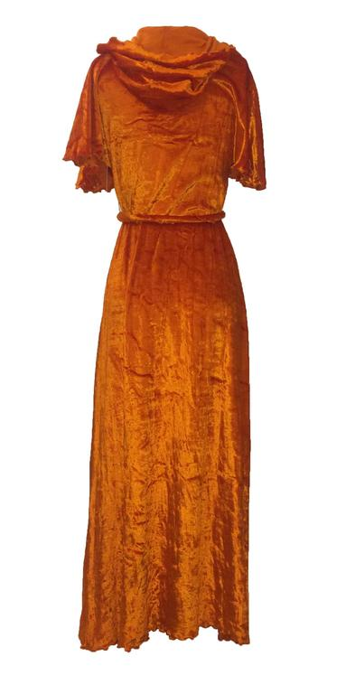 """Stephen Burrows Loungewear orange velour robe. Lettuce edge at hood, sleeves, and hem. Includes belt made of twisted velvet with exposed lettuce edge.   65% acetate, 35% cotton.  Size 10. Would best fit XS/S.  Bust 32"""" Waist 32"""" Hip"""