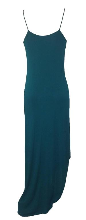 Iconic Stephen Burrows vintage 70s teal jersey bias cut dress with spaghetti straps and signature lettuce hem. Amazing beadwork at top bodice.