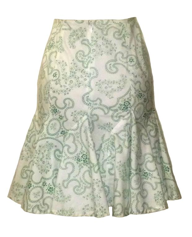 """Alaia green and white paisley pencil skirt with flared ruffle bottom.  Back zip and hook and eye.  100% cotton.  Made in Italy.  Labelled size FR 38, US 6. Runs small. Waist 26"""" Hip 34"""" Length 19"""".  Condition: Very good. One extremely"""