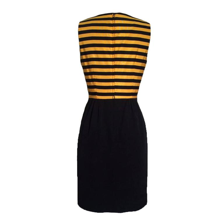 Moschino Cheap & Chic vintage 1980s yellow and black bumble bee stripe dress. Back zip.  Cloth 1: 70% cotton, 30% rayon.  Cloth 2: 60% cotton 40% rayon. Fully lined in 60% acetate 40% rayon.  Made in Italy.  Labelled IT 42, US 8. Fits like