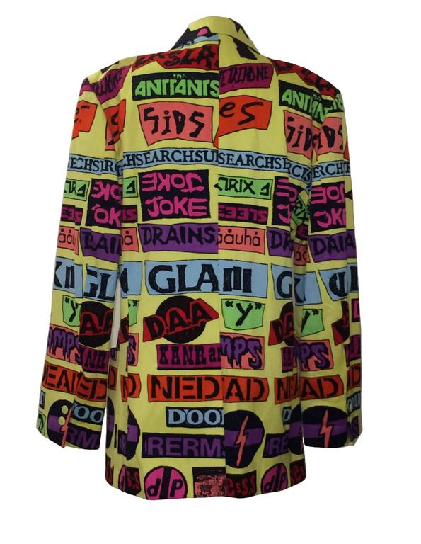 """Stephen Sprouse men's vintage band sticker jacket from 1988. Single breasted, double button. Patch pockets at front bottom.  100% cotton, fully lined in 100% rayon.   Made in Korea.  Size 40. Chest 42"""". Waist 38"""". Shoulder seam to shoulder"""