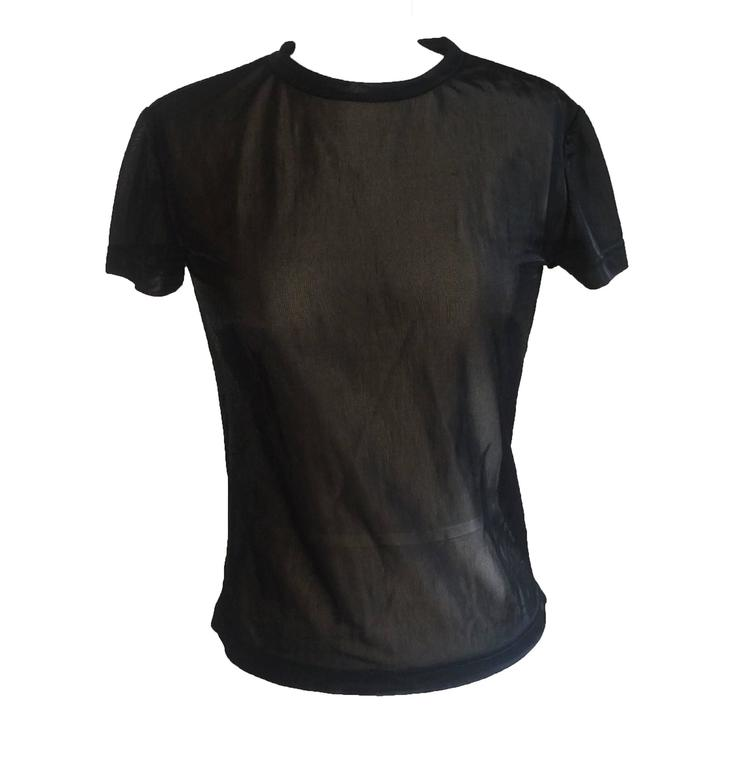 "Alexander McQueen rare & iconic 'McQueen 00' black mesh t-shirt with metallic silver embroidery at back from the 2000 collection. Sheer, glossy, fine-knit mesh.  Made in Italy.  Size label removed, fits like XS/S. Bust 32"". Waist"