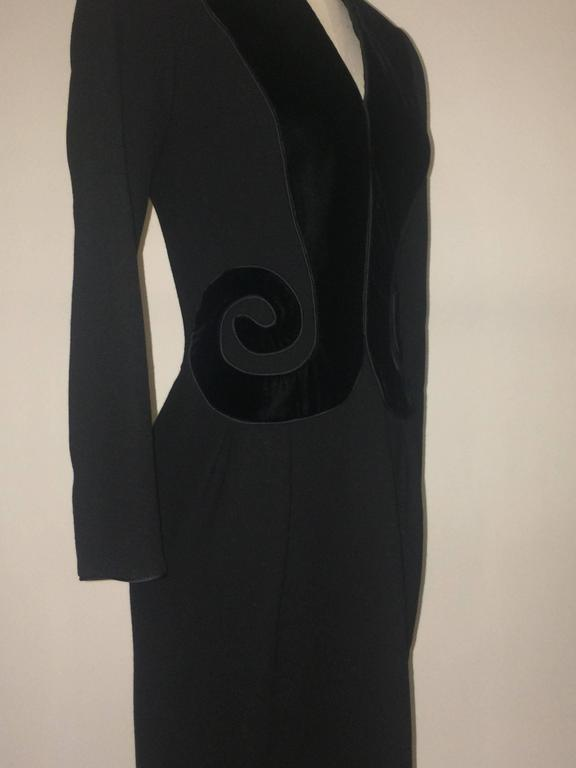 Oscar de la Renta early 1990s long sleeved black dress with back zip. Black velvet swirls at front and padded shoulders give the dress a bit of a Schiaparelli vibe.  Made in USA.   Content unknown-- heavier wool crepe?  Size 8. Runs small, see