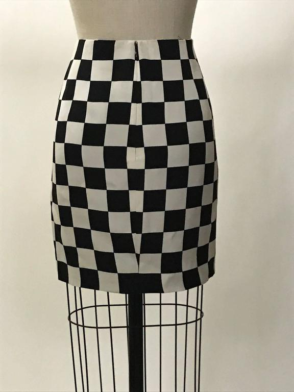 Iconic Gianni Versace Couture vintage 1990s black and white checked mini pencil skirt. Back zip and hook and eye. 