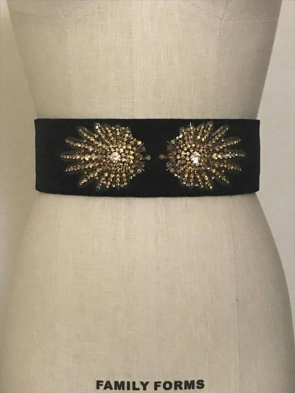 """Alexander McQueen black velvet wide waist belt with goldtone crystal and beaded embellishment at front. Fastens at back with three hidden snaps.  Labelled size 26, but runs small, see measurements. Fits a size XXS/0. 2 3/4"""" wide. Approximately 24"""