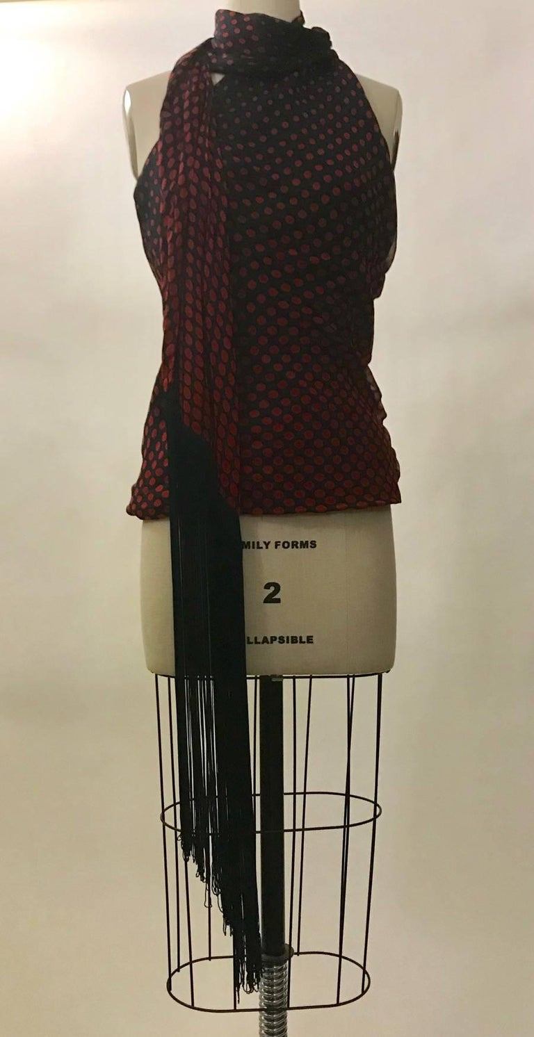 Alexander McQueen red and black polka dot halter top with attached scarf that wraps around the neck to close (designed to stay up by just wrapping the scarf, those desiring a little extra security may want to add a brooch.) Long fringed trim at end