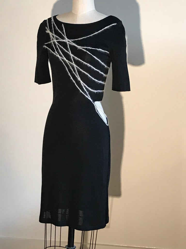 Gianni Versace Couture vintage 1990s little black knit dress with short sleeves, fuzzy angora braided yarn embellishment at bodice, and asymmetrical cut out at side waist.  97% rayon, 2% mohair, 1% nylon. Unlined.  Made in Italy.  Labelled size IT