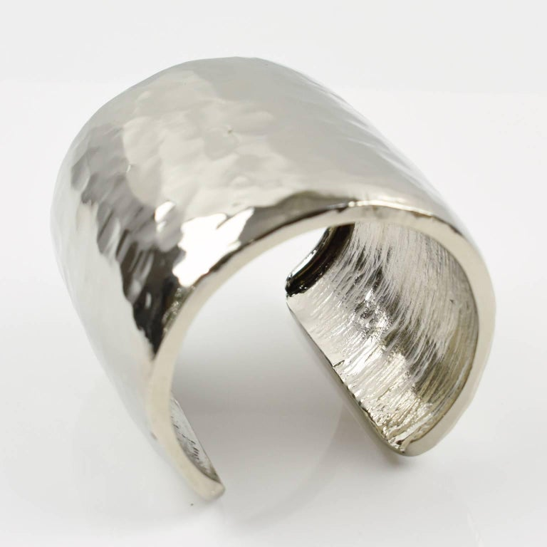 Stunning Guy Laroche Paris signed cuff bracelet. Brutalist slave design with hand-made feel, silvered metal extremely shinny with slight hammered finish. Engraved signature in the inside: 'Guy Laroche - Paris'. Measurements: inside across 2.38 in.