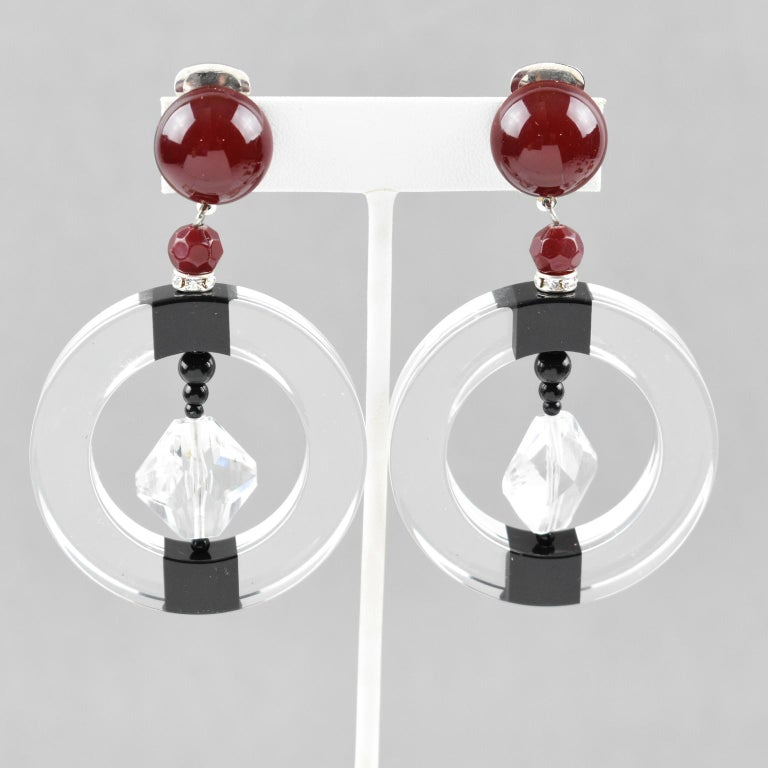 Stunning Angela Caputi, made in Italy resin clip on earrings. Oversized dangling design with large crystal clear hoop ornate with black and burgundy red elements and topped with clear rhinestones spacer ring. Her matching of colors is always