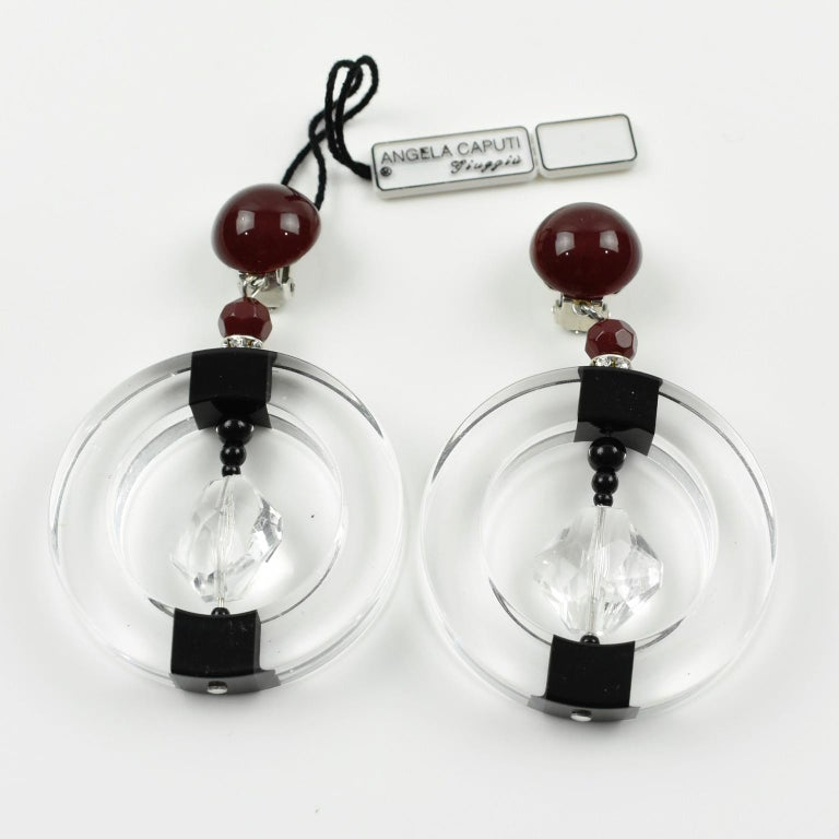 Angela Caputi Large Hoop Dangling Black and Clear Resin Clip On Earrings In Excellent Condition For Sale In Atlanta, GA