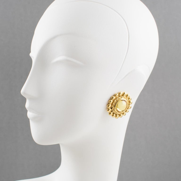 Elegant French fashion designer Sonia Rykiel Paris signed clip on earrings. Featuring gilt metal rounded shape with textured topped with large resin cabochon in light champagne color. Signed underside: Sonia Rykiel - Paris.  Measurements: 1.38 in.