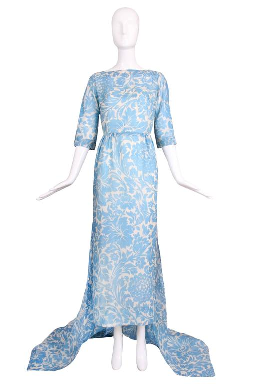 Vintage Pauline Trigere linen light blue and white floral gown with open back and train. Comes with white silk slip attached at the interior. In excellent condition. No size tag so please consult measurements.