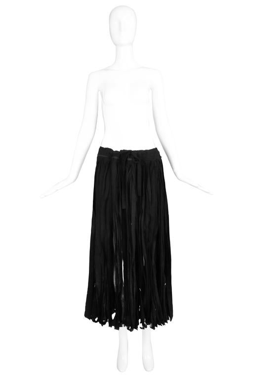 Yohji Yamamoto black 100% cotton carwash skirt with adjustable drawstring waist. In excellent condition. Size tag 2 but because of the waist design, will fit multiple sizes. MEASUREMENTS: Waist - 30