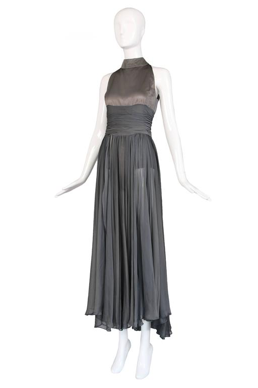 Circa 2003 Chloe by Stella McCartney gray silk chiffon and satin polyester evening gown with open chiffon paneled skirt and visible body suit/hot pants underneath. In very good to excellent condition with two or three light stains in the chiffon