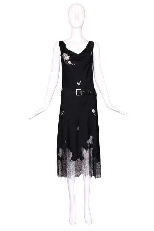 John Galliano black silk and lace bias cut sleeveless evening or cocktail dress with detachable rhinestone buckle belt. Size 6. In excellent condition.