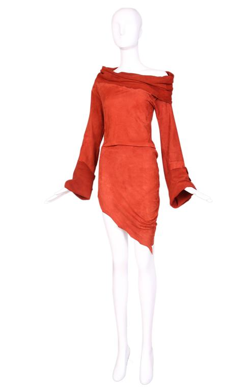 Vintage Jean Paul Gaultier burnt orange suede asymmetrical tunic with bell sleeves and over-sized cowl neck that can be worn off the shoulder. Edges of hem and cuffs are hand cut to look uneven. In excellent condition with some minor light, hard to
